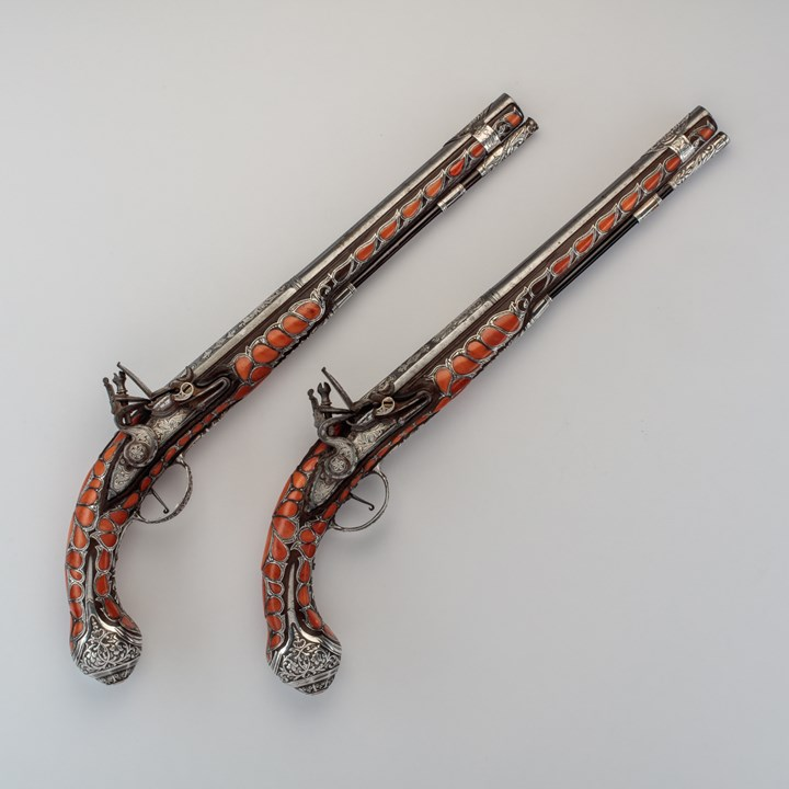Pair of Coral-Decorated Pistols
