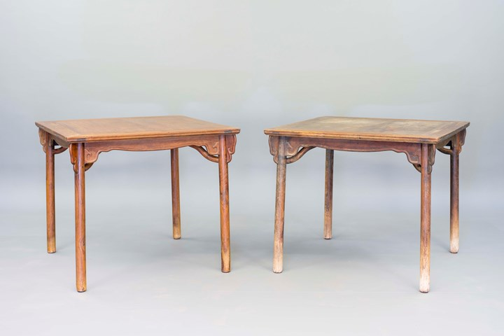 A pair of huanghuali square tables with triple aprons and stretchers