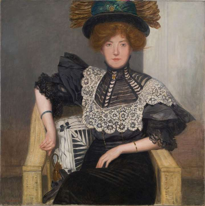PORTRAIT OF A LADY WITH LACE BLOUSE AND FEATHERED HAT
