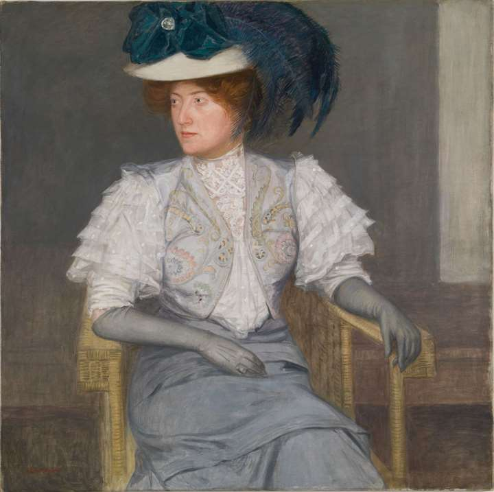 PORTRAIT OF A LADY WITH GREEN FEATHERED HAT AND BOW
