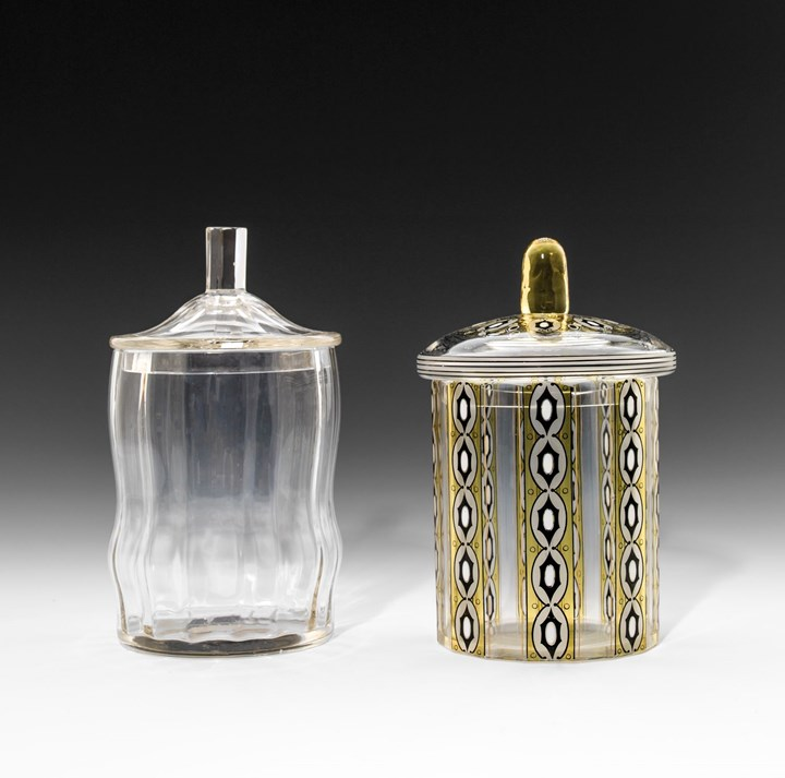 TWO LIDDED GLASS JARS
