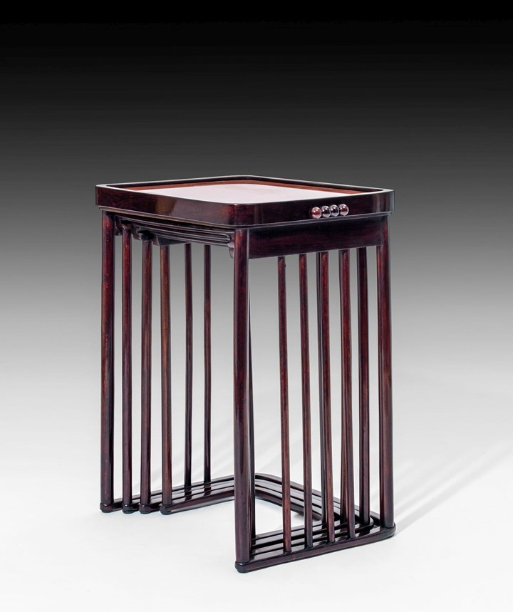A SET OF FOUR NESTING TABLES