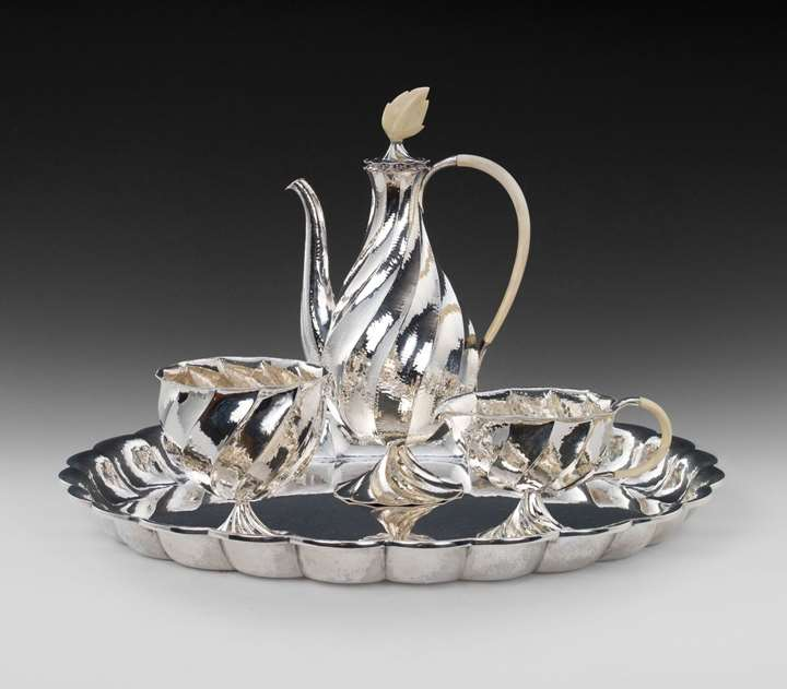 SILVER COFFEE SERVICE consisting of: coffee pot, milk jug, sugar bowl, oval tray