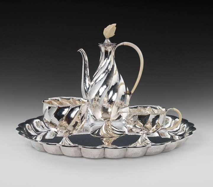 SILVER COFFEE SERVICE consisting of: coffee pot, milk jug, sugar bowl, oval tray