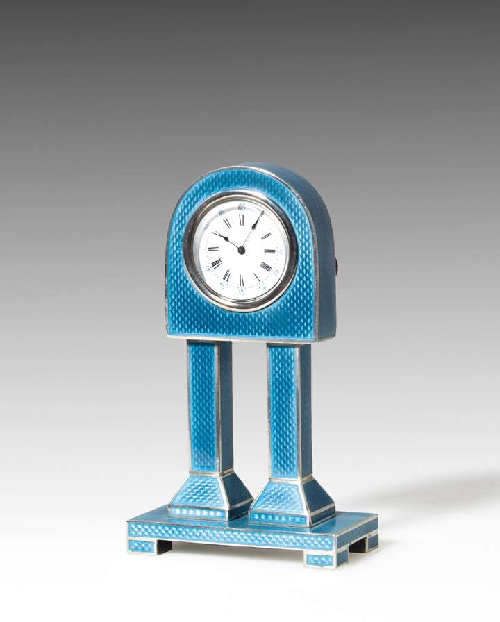 SMALL SILVER AND ENAMEL COLUMN CLOCK