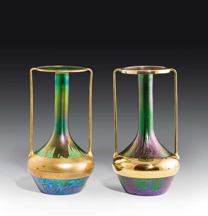A pair of vases with brass mount