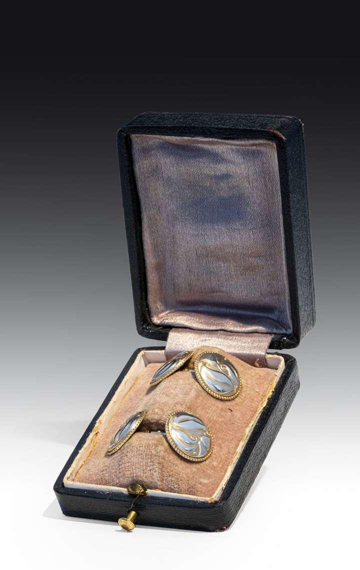A pair of silver cufflinks