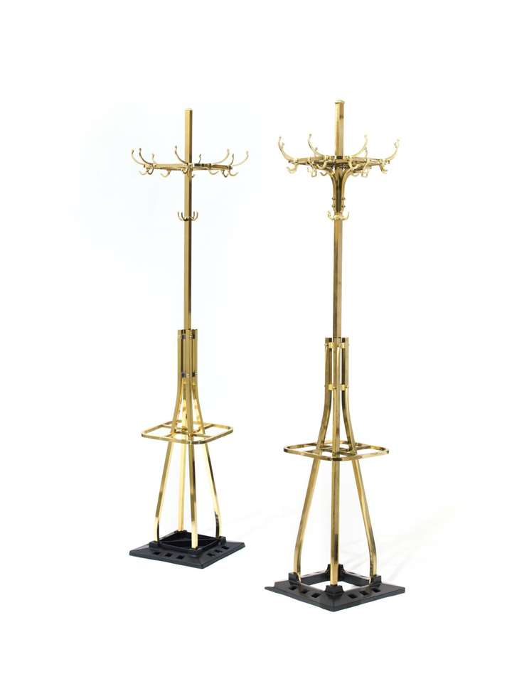 A PAIR OF COAT AND HAT STANDS