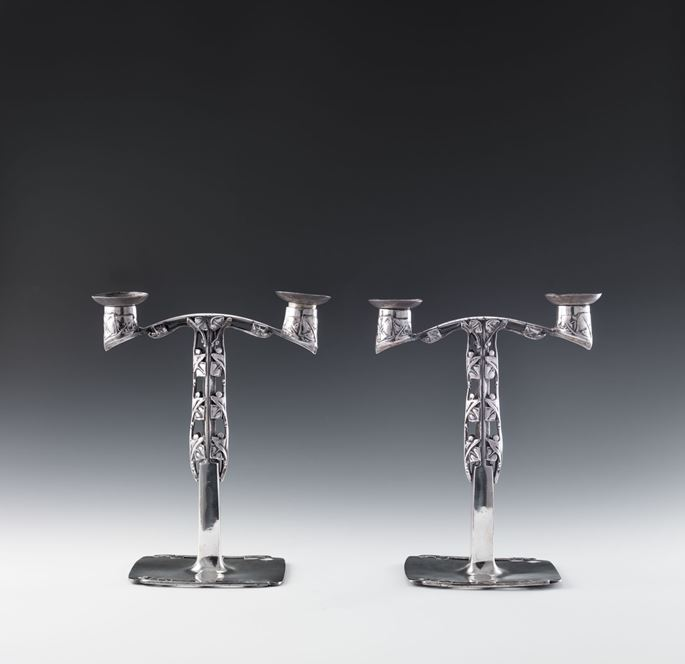 "Archibald Knox - A PAIR OF ""TUDRIC"" PEWTER CANDELABRA 