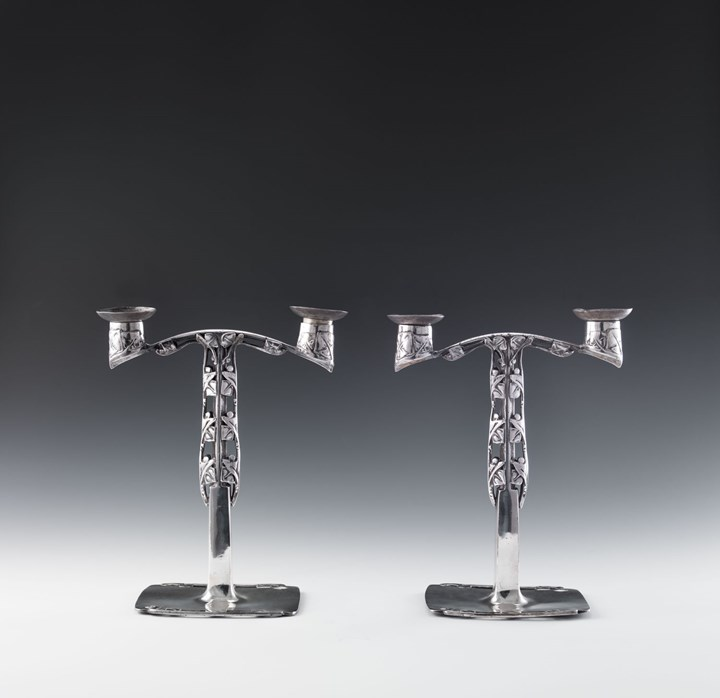 "A PAIR OF ""TUDRIC"" PEWTER CANDELABRA"