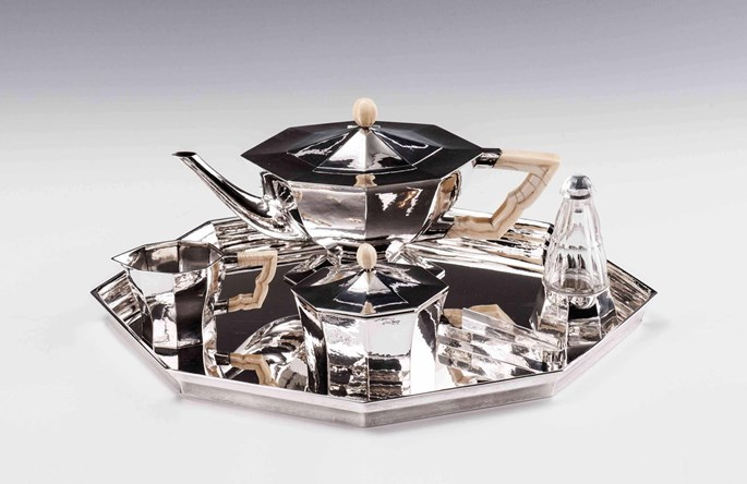Eduard Josef Wimmer-Wisgrill - SILVER TEA SERVICE consisting of: teapot, creamer, covered sugar bowl, sugar tongs, rum flacon, tray  | MasterArt