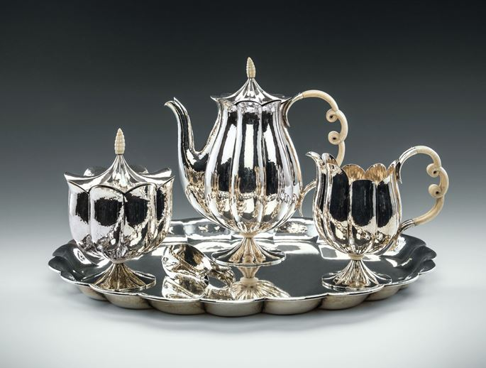 Josef  Hoffmann - MUSEUM-QUALITY SILVER TEA SET consisting of: teapot, creamer, covered sugar bowl, sugar tong, tray   | MasterArt