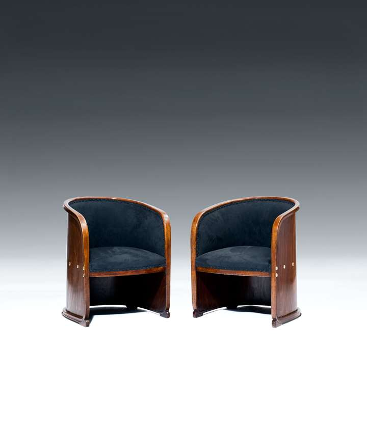 TWO ARMCHAIRS so-called BARREL CHAIRS
