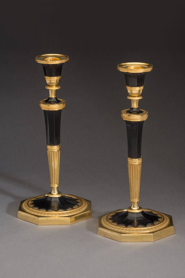 A pair of Empire Ormolu candlesticks