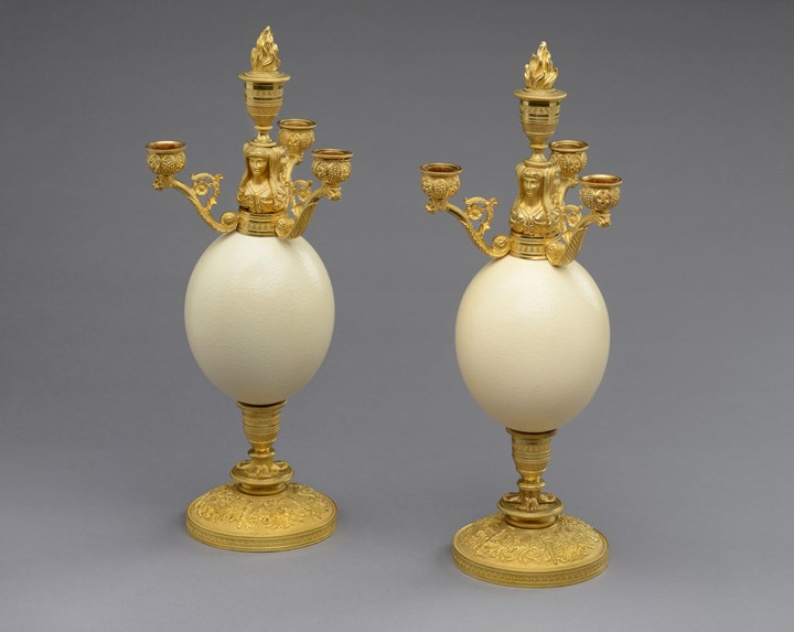 A pair of restauration ostrich eggs ormolu mounted four branches candelabra