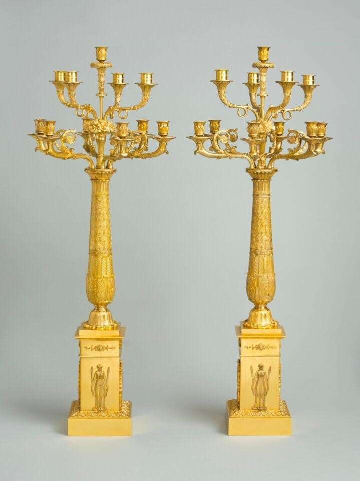 An important pair of empire berlin ormolu candelabra