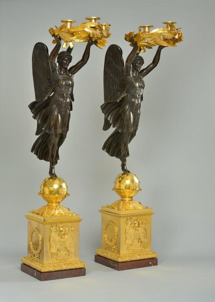 A VERY IMPORTANT PAIR OF EMPIRE FOUR-LIGHT CANDELABRA