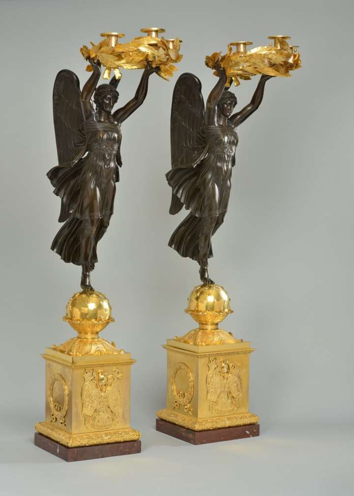 A very important pair of empire ormolu and patinated bronze four-light candelabra