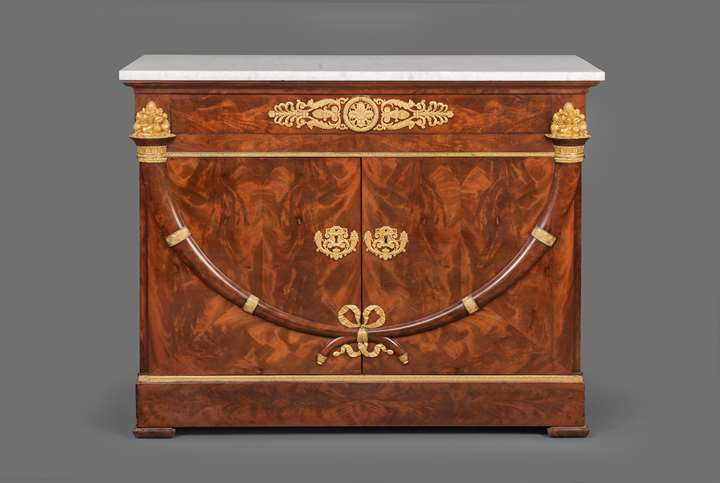 A ormolu mounted mahogany empire commode a vantaux