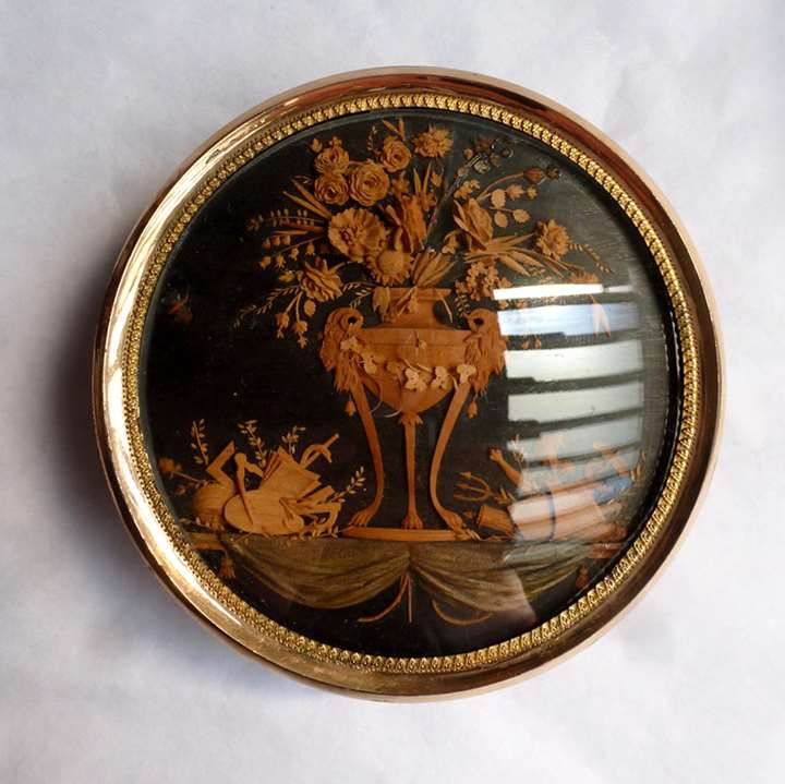 A North Italian Circular Tortoiseshell and Gold Mounted Snuff box with a wood micro-carving