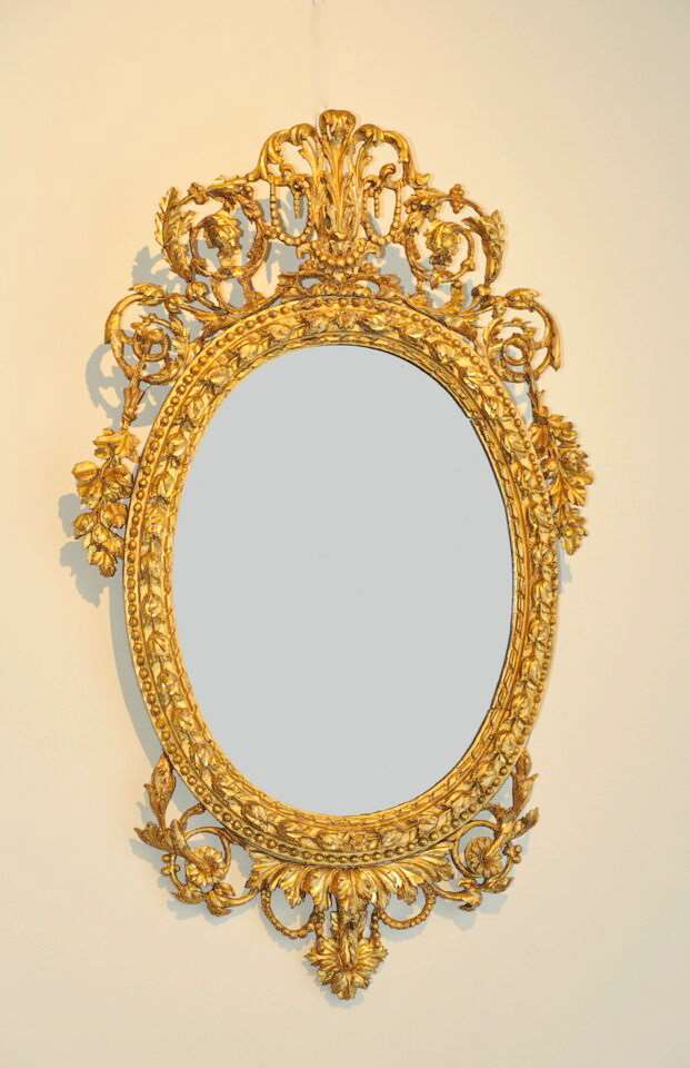 A Pair of Neoclassical micro-sculpted Italian Giltwood oval Mirrors