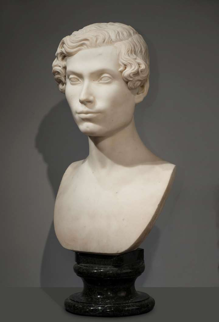 White marble bust of nobleman, on the original verde arno marble base