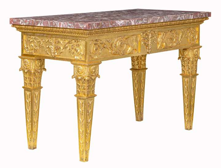 An Italian carved and giltwood neoclassical Console table, with a rectangular peperino top with Roman ancient alabastro a pecorelle veneer