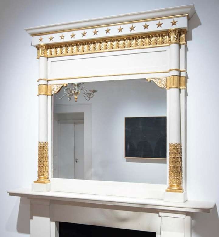 A neoclassical gilt and lacca mantel mirror