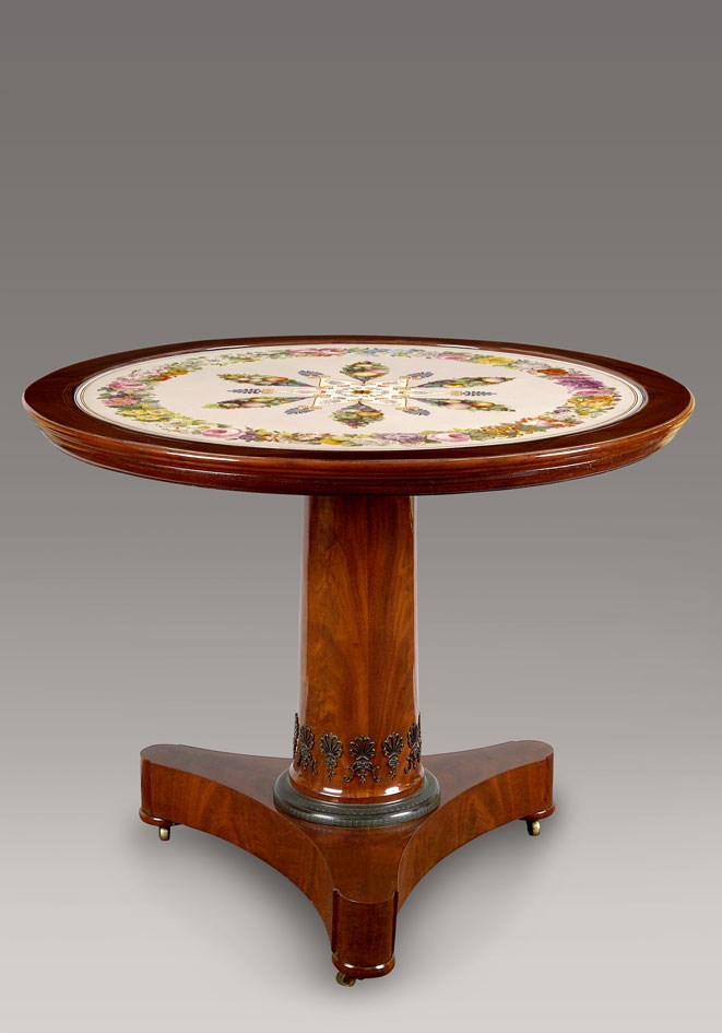 "A Restauration mahogany gueridon with original ""lave emailee"" table top"