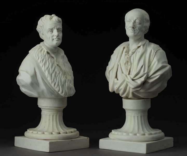 Two portrait busts of Rousseau and Voltaire