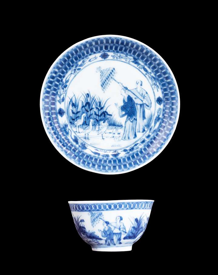 Chinese export porcelain blue and white teabowl and saucer with the Parasol pattern after Cornelis Pronk