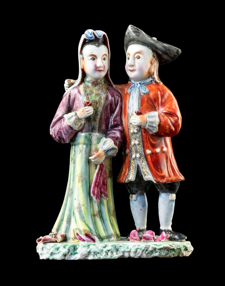 GG: Chinese porcelain figure group of a standing Dutch couple