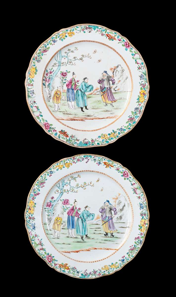 GG: Pair of Chinese export porcelain famille rose large chargers with Chinese figures