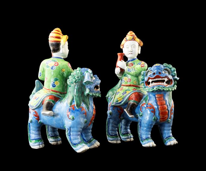 GG: Pair of Chinese porcelain famille rose figures of riders on Buddhist lions | MasterArt