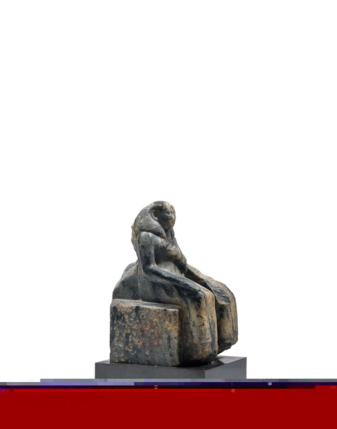 An Egyptian gneiss seated fragmentary statue of a couple | MasterArt