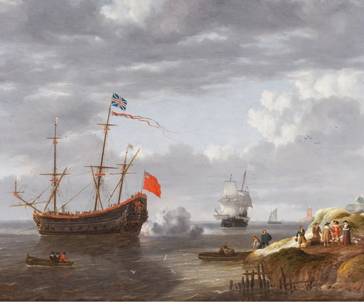 A Ship firing a Salute close to the Shore.