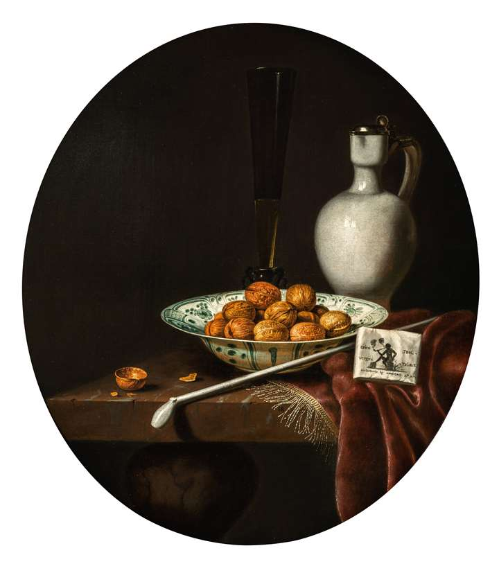 Still Life of Walnuts in a Wan-Li Porcelain Bowl, a glazed Earthenware Jug, and a Pipe and Smoking Materials on a partly draped Table.
