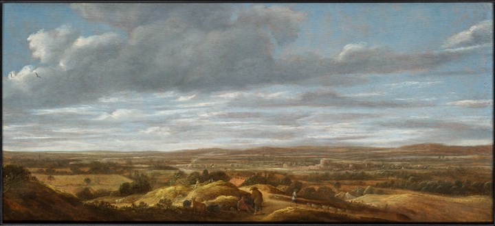 An extensive landscape with huntsmen resting on a path, a town beyond.