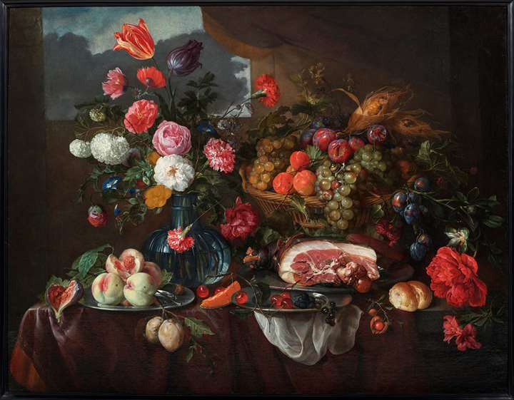 Still life of a vase of flowers, a basket of fruit and some flowers, a ham and a sausage on a pewter dish, fruit on pewter plates, and a bread roll.