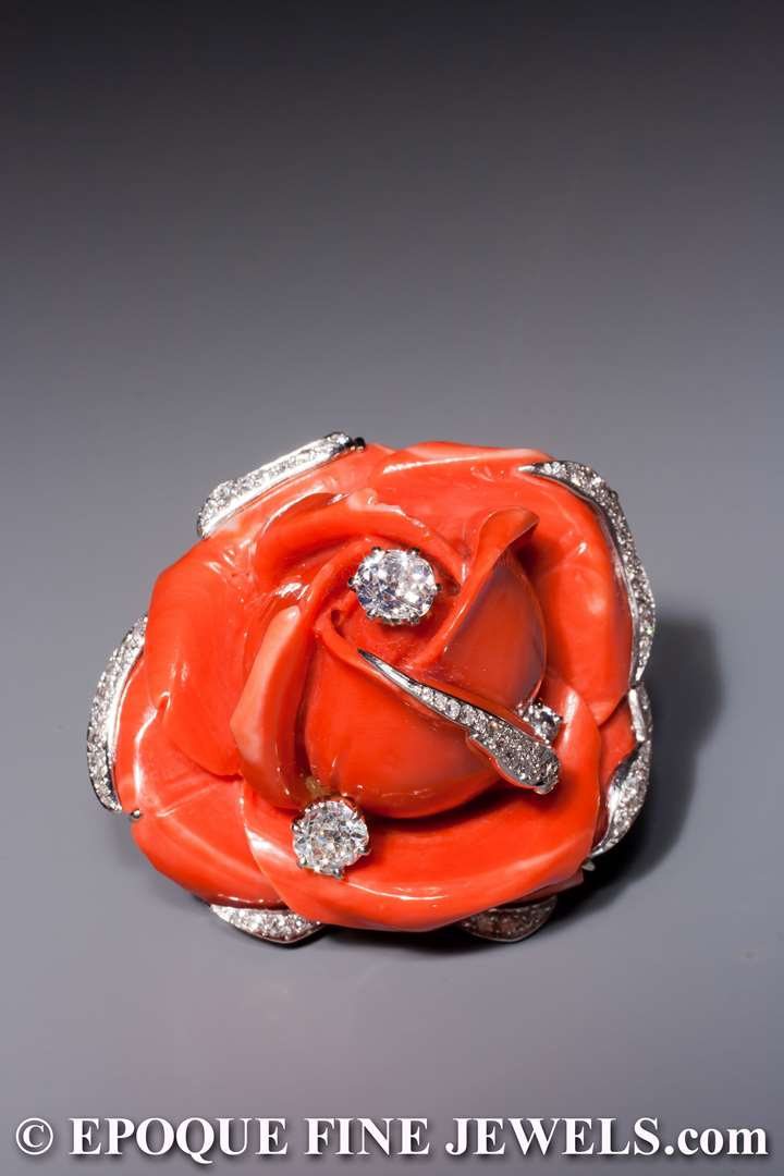 A beautiful 1950ies coral and diamond flower clip brooch