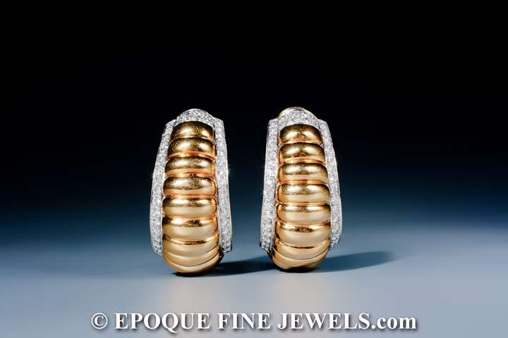 A fine pair of 18 karat gold and diamond earrings,