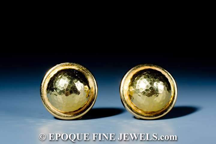 A funky pair of 18 karat gold earrings,