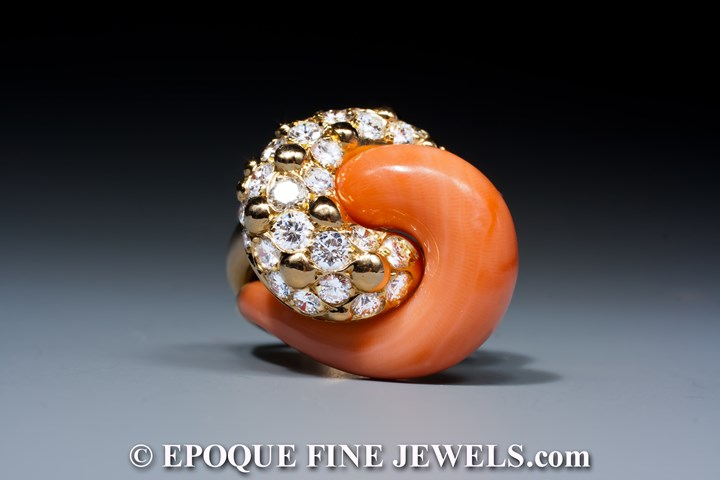 A very fine coral and diamond swirl ring,