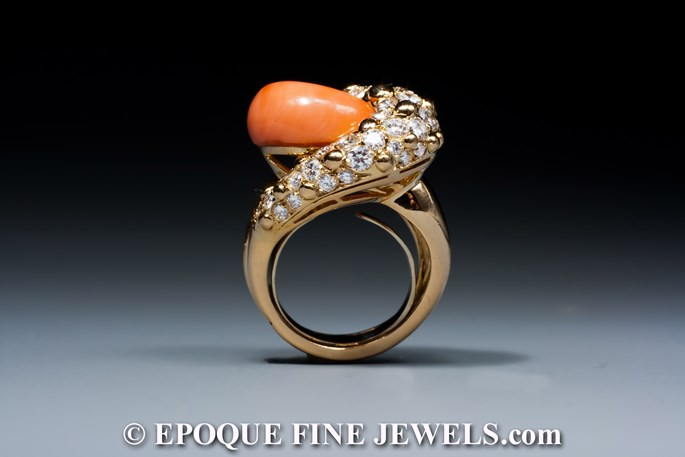 A very fine coral and diamond swirl ring | MasterArt