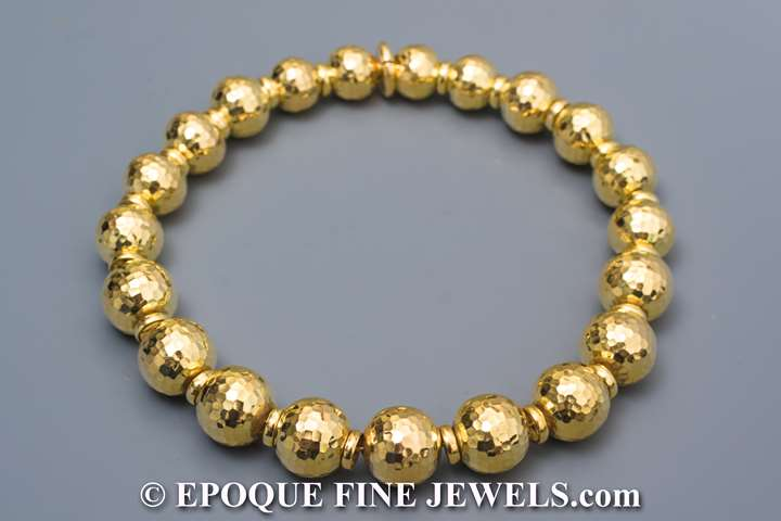 An 18 carat gold ball necklace