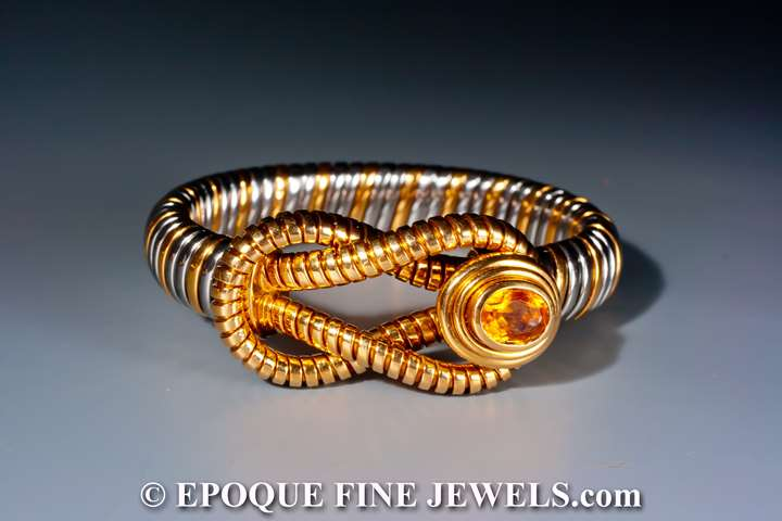 An 18 karat gold and stainless steel bracelet