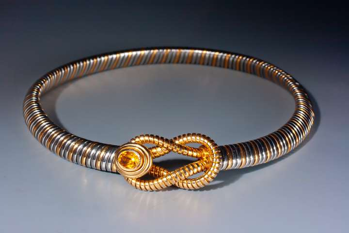 An 18 karat gold and stainless steel necklace