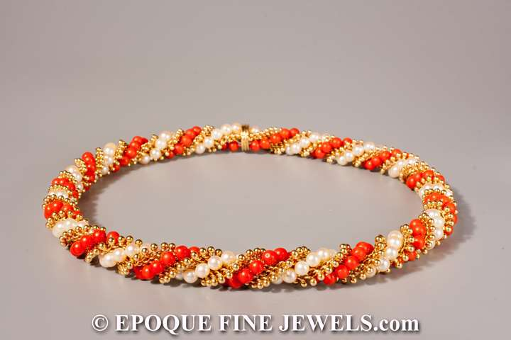 An 18 karat gold, pearl and coral torsade necklace,