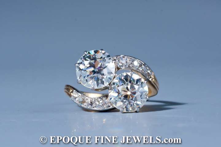 An Edwardian diamond cross over ring,