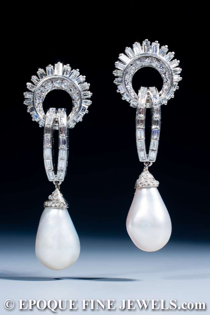 An exquisite pair of natural pearl and diamond earrings
